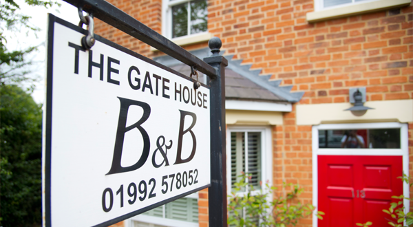 the gate house front of house featured image